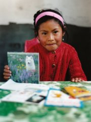 A sponsored child with letters from her sponsor